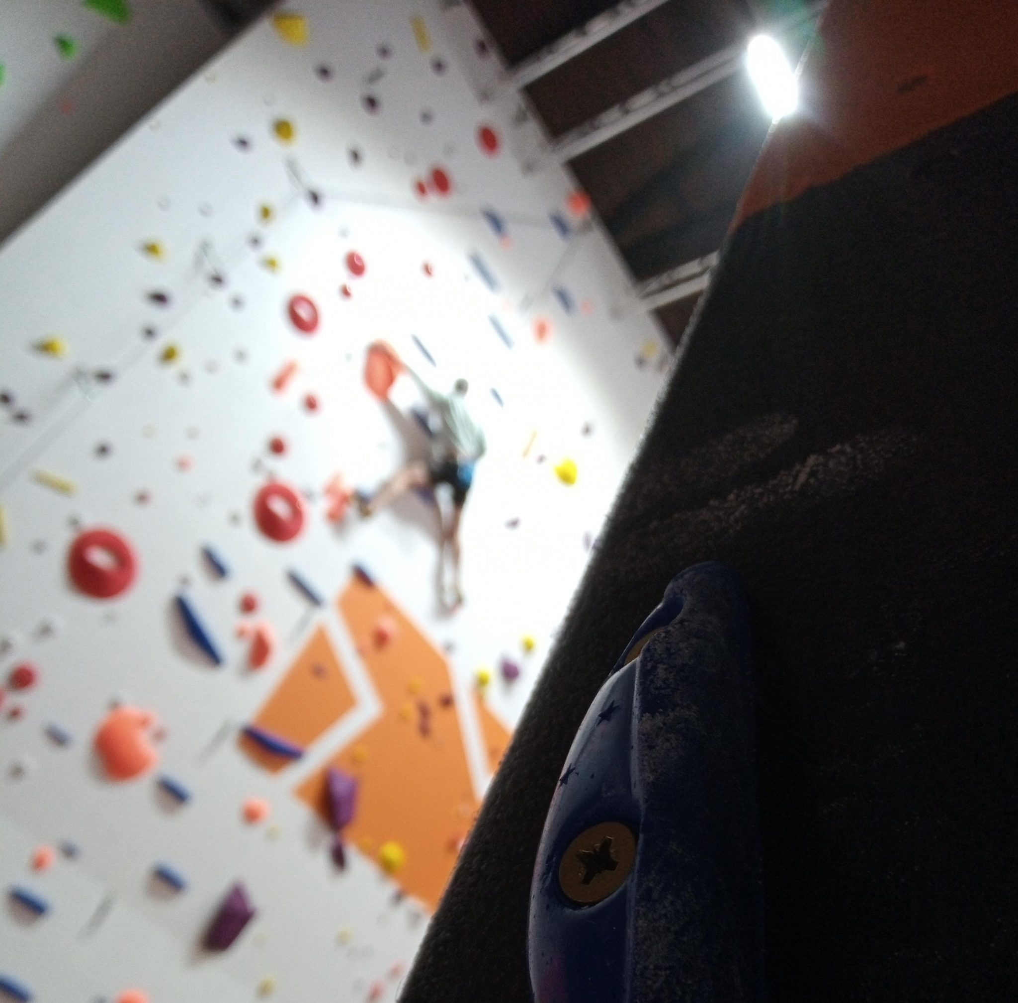 Overhang Climbing Centre Carmarthen close up hold and climber in background